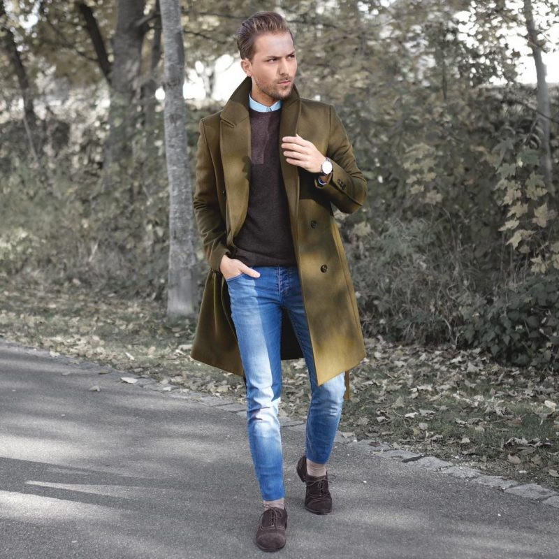 Olive green overcoat, brown sweater, blue jeans 1