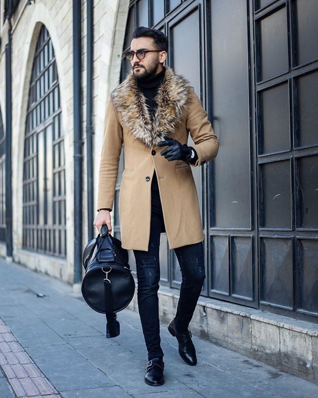 Camel overcoat with fur lapels, black turtleneck t-shirt, blue jeans 1