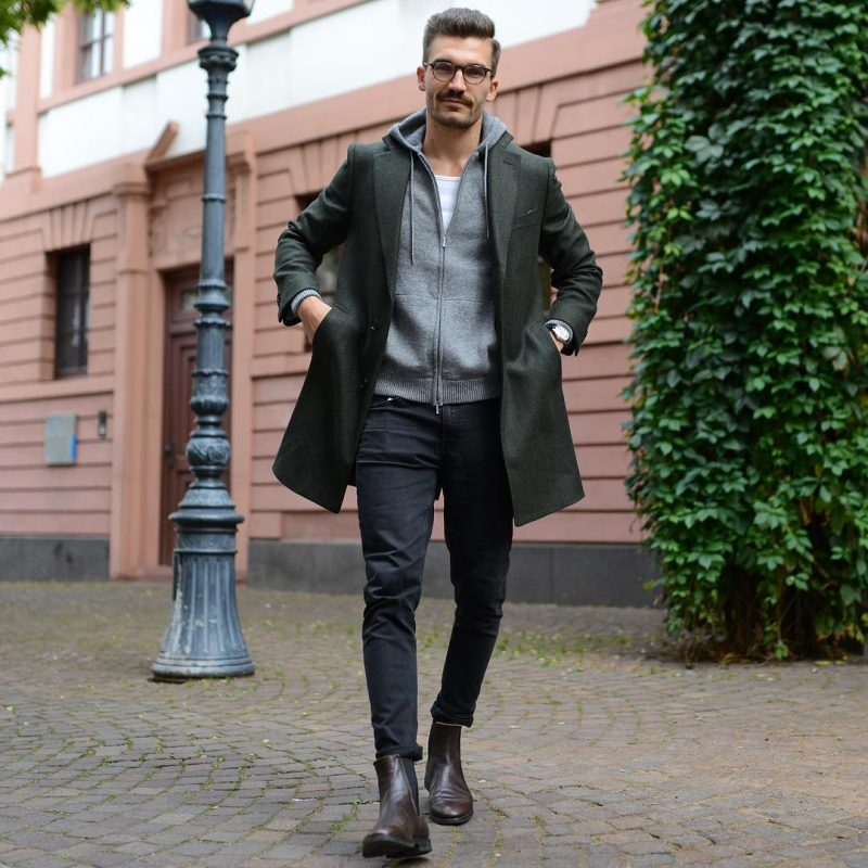 Black overcoat, grey hoodie jacket, white singlet, dark brown Chelsea boots 1