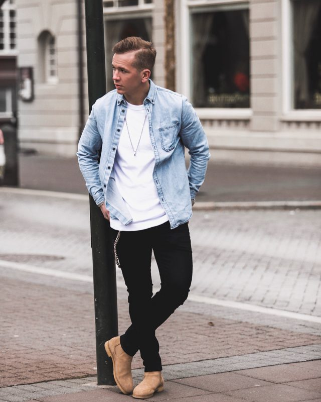 40 mens winter work outfit styles with winter boots. Tan suede Chelsea boots, blue overshirt, white t-shirt, black jeans 1