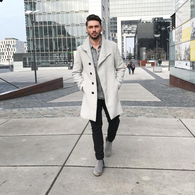 40 mens winter work outfit styles with winter boots. Grey Chelsea boots, grey overcoat, denim shirt, black jeans 1