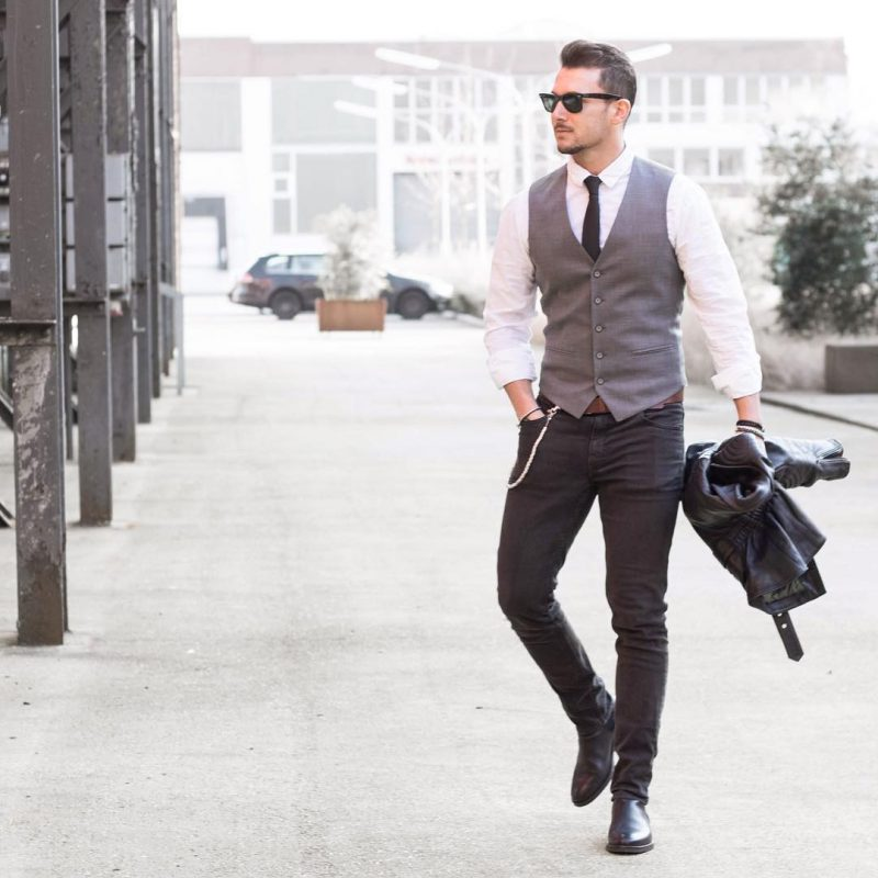 40 mens winter work outfit styles with winter boots. Leather Chelsea boots, white shirt, tie, suit vest, black jeans 1