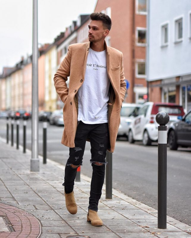 40 mens winter work outfit styles with winter boots. Tan suede Chelsea boots, tan overcoat, white print t-shirt 1