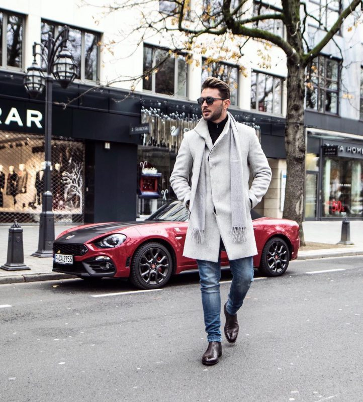 40 mens winter work outfit styles with winter boots. Dark brown Chelsea leather boots, overcoat, scarf, black button up shirt 1