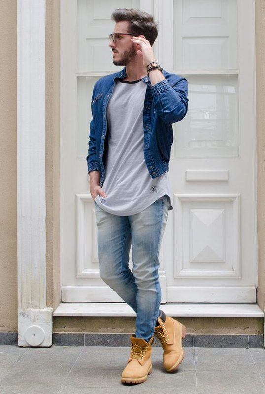 40 mens winter work outfit styles with winter boots. Orange work boots, denim jacket, grey t-shirt, jeans 1