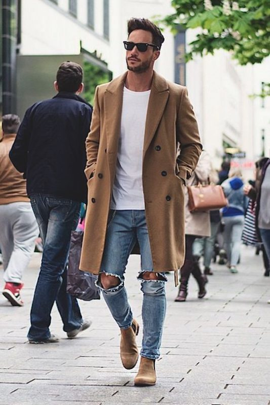 40 mens winter work outfit styles with winter boots. Tan suede Chelsea boots, tan overcoat, white shirt, blue jeans 1