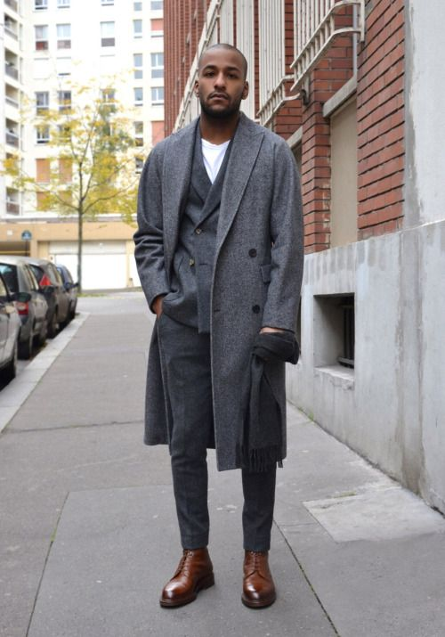 40 mens winter work outfit styles with winter boots. Brown plain toe leather boots, grey overcoat, suit pants 1